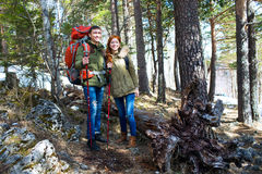 Tourists couple man and woman in  woods with a backpack Royalty Free Stock Photos