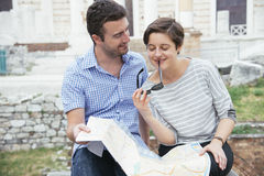 Tourists couple map Stock Photography