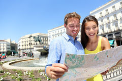 Tourists couple with map in Madrid, Spain Stock Images