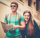 Tourists couple with map in old city Royalty Free Stock Photography