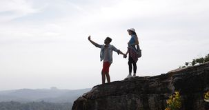 Tourists Couple Stand On Mountain Top Making Video Landscape On Cell Smart Phones, Young Man And Woman Travelers Holding. Hands Slow Motion 60 stock video