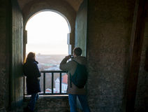 Tourists couple take pictures of old city landmarks Royalty Free Stock Photography