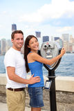 Tourists Couple - Tourism New York, USA. Happy romantic dating interracial couple sightseeing looking at Manhattan and New York City skyline from Ellis Island stock photos