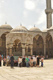 Tourists in the courtyard of Sultanahmet Mosque Stock Photo