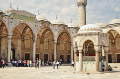 Tourists in the courtyard of Sultanahmet Mosque Royalty Free Stock Image
