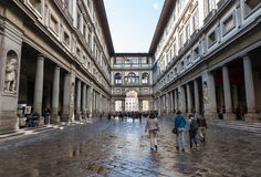 Tourists on courtyard of Uffizi Gallery. FLORENCE, ITALY - NOVEMBER 6, 2016: tourists on yard Uffizi Gallery. Uffizi Gallery is one of the oldest museums in Stock Photo