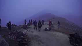 Tourists at crater rim of Ijen volcano in Indonesia. stock video