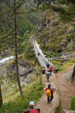 Tourists crossing a bridge in the Himalayas Royalty Free Stock Photo