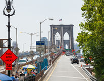 Tourists crossing the Brooklyn Bridge Royalty Free Stock Photography