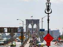 Tourists crossing the Brooklyn Bridge Royalty Free Stock Photos