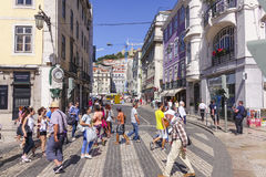 Tourists crossing the street in Lisbon