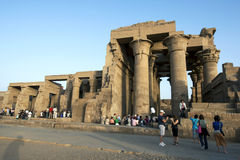 Tourists crowd around the ruins of the Kom Ombo Temple on the River Nile in Egypt in the late afternoon. Stock Images