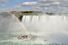 Tourists Crowd the decks of the Hornblower Ferry Boat on the Niagara River. The Hornblower struggles against the powerful current as it takes its passengers for stock images