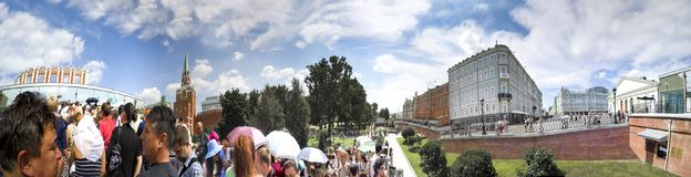 Tourists crowd at Entrance in Moscow Kremlin via Trinity Tower. MOSCOW, RUSSIA - circa AUGUST, 2016: Tourists crowd at Entrance in Moscow Kremlin via Trinity stock photo