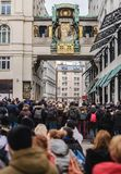 Tourists Crowd in front of Anchor Clock. Vienna, Austria - December 30, 2017. Tourist crowd in front of famous Anker Clock chimes on Hoher Markt. Oldest square stock photography