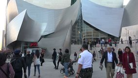 Crowds at the entrance to the Walt Disney Concert Hall. Tourists crowd near the entrance to the Walt Disney Concert Hall stock video