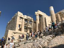 Tourists crowd paths built for them through the restoration of t. Oct 2017: Tourists crowd the steps built for them through the restoration of the Acropolis royalty free stock photo