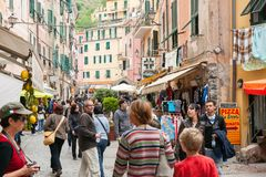 Tourists crowd traditional Italian village street lined with sou. MONTEROSSO ITALY - APRIL 25 2011; Tourists crowd traditional Italian village street lined with stock image