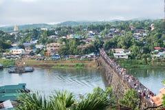 Tourists crowd travel on wooden mon bridge landmark in sangkhlaburi. Kanchanaburi, thailand royalty free stock photography