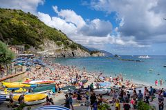 Tourists at crowded beach Monterosso al Mare, Italy. Stock Photography