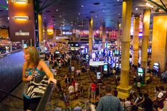 Tourists in crowded casino Stock Photography