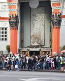 Tourists Crowding at Grauman`s Chinese Theatre. Los Angeles, CA - March 20, 2018: Tourists crowding into the courtyard at the TCL Grauman's Chinese stock images