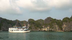 Cruise Boats in Ha Long Bay, Cat Ba National Park, Vietnam. TOURISTS AND CRUISE BOATS IN HA LONG BAY, CAT BA NATIONAL PARK, NORTH EAST VIETNAM – 4 APRIL 2018 stock footage