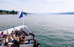 Tourists on cruise ship with flag in lake Zurich stock photo