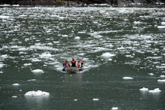 Tourists from the cruise ship in the Garibaldi fjord in the archipelago of Tierra del Fuego. Stock Photos