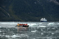 Tourists from the cruise ship landed on the shore near Pia glacier. Royalty Free Stock Images