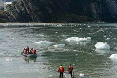 Tourists from the cruise ship landed on the shore near Pia glacier. Stock Photos