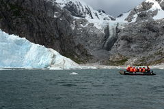 Tourists from the cruise ship at the Nena Glacier. Royalty Free Stock Photo