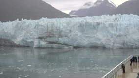 Tourists on a Cruise Ship View Margerie Glacier. Tourists aboard a cruise ship view Margerie Glacier near Glacier Bay, Alaska stock video footage