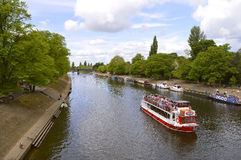Tourists cruising along river Ouse Stock Image