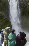 Tourists on the cruising boat approaching Stirling Falls , Milford Sound, Fiordland, South Island of New Zealand Stock Photography