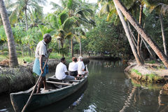 Tourists cruising on a canoe a river of the backwaters at Kollam Royalty Free Stock Photos