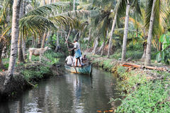Tourists cruising on a canoe a river of the backwaters at Kollam Royalty Free Stock Images
