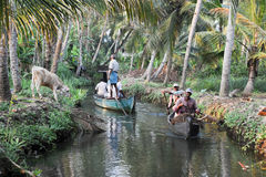Tourists cruising on a canoe a river of the backwaters at Kollam Stock Photography