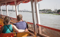 Tourists are cruising the river.  travel in Bangkok by Boat. Stock Photos