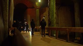 Tourists at the crying column in the Basilica Cistern