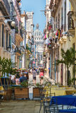 Tourists and cubans on a colorful street in Havana. Tourists and cubans on a colorful street  in Old Havana Royalty Free Stock Photography