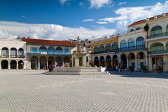 Tourists and cubans in a square in Havana. Tourists and cubans in a square in Old Havana a.Old Havana with its typical colonial architecture is a major Stock Image