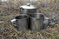 Tourists cups on dry grass Stock Photo