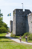 Tourists and cyclists city wall Visby Stock Image