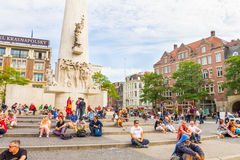 Tourists in the Dam square in Amsterdam, The Netherlands Royalty Free Stock Images