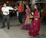 Tourists Dance with Bollywood Dancers in India Stock Images