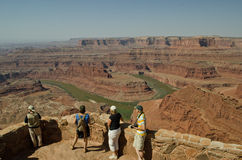 Tourists at the Dead Horse view point. Tourists watching the river bend in Dead Horse Point State Park in Utah stock image