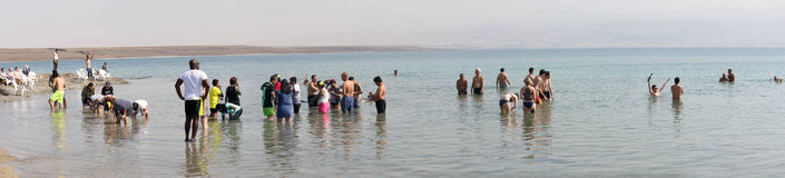 Tourists at Dead Sea, Israel Stock Photo