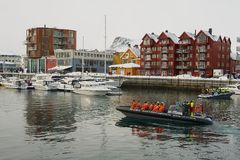 Tourists Depart For Boat Safari From The Harbor Of Svolvaer, Norway. Stock Photography