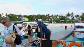 Tourists departure from Raya Island. KOH RACHA YAI, THAILAND - NOVEMBER 20, 2017: Tourists walking on grey pontoon oboard speedboat at Koh Racha Yai Island stock video